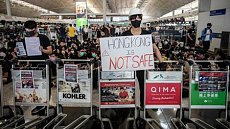 Click image for larger version.  Name:hong-kong-airport-protest.jpg Views:0 Size:52.0 KB ID:6932